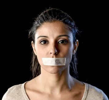 woman has tape on her mouth